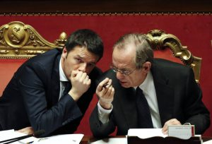 Italy's PM Renzi talks with Finance Minister Padoan during a confidence vote at the Senate in Rome