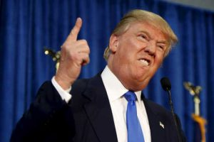 """Republican presidential candidate Trump gestures and declares """"You're fired!"""" at a rally in Manchester"""