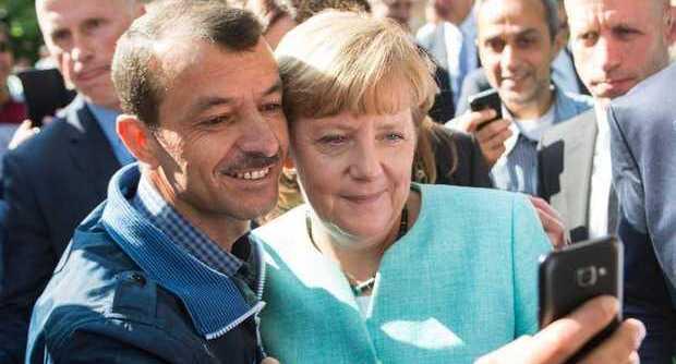 Merkel profughi salario ridotto