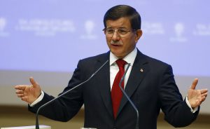 Turkey's Prime Minister Ahmet Davutoglu speaks during a meeting at his ruling AK Party headquarters in Ankara, Turkey, August 28, 2015. Davutoglu said he would present the list of names for an interim power-sharing cabinet to President Tayyip Erdogan later on Friday. The new cabinet, expected to include at least two names from the pro-Kurdish opposition HDP, will be tasked with leading Turkey to a snap parliamentary election on Nov. 1. REUTERS/Umit Bektas - RTX1Q0AN