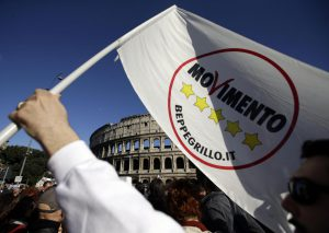"Activists of the anti-establishment 5 Star Movement gather in front of the ancient Colosseum in Rome, Sunday, April 21, 2013. A day after Italy's president was re-elected to an unprecedented second term, the leader of an anti-establishment movement says citizens' patience with traditional parties is wearing thin. Beppe Grillo, a comic who heads the Five Star Movement, has dismissed President Giorgio Napolitano's re-election as a bid by doomed parties to hang onto power. Grillo, whose party is the No. 3 bloc in Parliament, predicted in Rome on Sunday that traditional parties would ""last a year."" (AP Photo/Gregorio Borgia)"