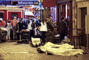 A soldier stands by victims in the10th district of Paris, Friday, Nov. 13, 2015. (AP Photo/Jacques Brinon)