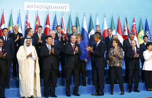 Members of the Group of 20 (G20) applaud after posing for the traditional family photo during the G20 leaders summit in the Mediterranean resort city of Antalya, Turkey, November 15, 2015. REUTERS/Murad Sezer