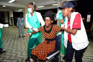 273BFB3800000578-3022586-Treatment_Paramedics_attend_to_an_injured_Kenyan_student_as_she_-a-5_1428013568266