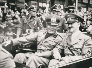 The AssocIated Press files In this Sept. 28, 1938, photo, Italian dictator Benito Mussolini (left) and Adolf Hitler take a ride before a conference in Munich, Germany.