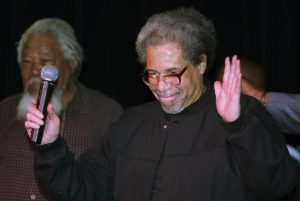 """Albert Woodfox arrives on stage during his first public appearance at the Ashe Cultural Arts Center in New Orleans, Friday, Feb. 19, 2016 after his released from Louisiana State Penitentiary in Angola, La. earlier in the day. Woodfox is the last of three high-profile Louisiana prisoners known as the """"Angola Three"""" to be released.  (ANSA/AP Photo/Max Becherer)"""
