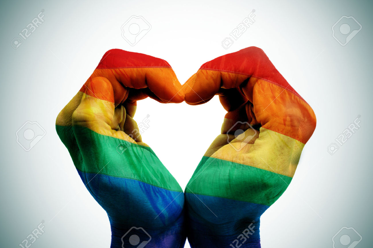 28469506-man-hands-patterned-as-the-rainbow-flag-forming-a-heart-symbolizing-gay-love-Stock-Photo