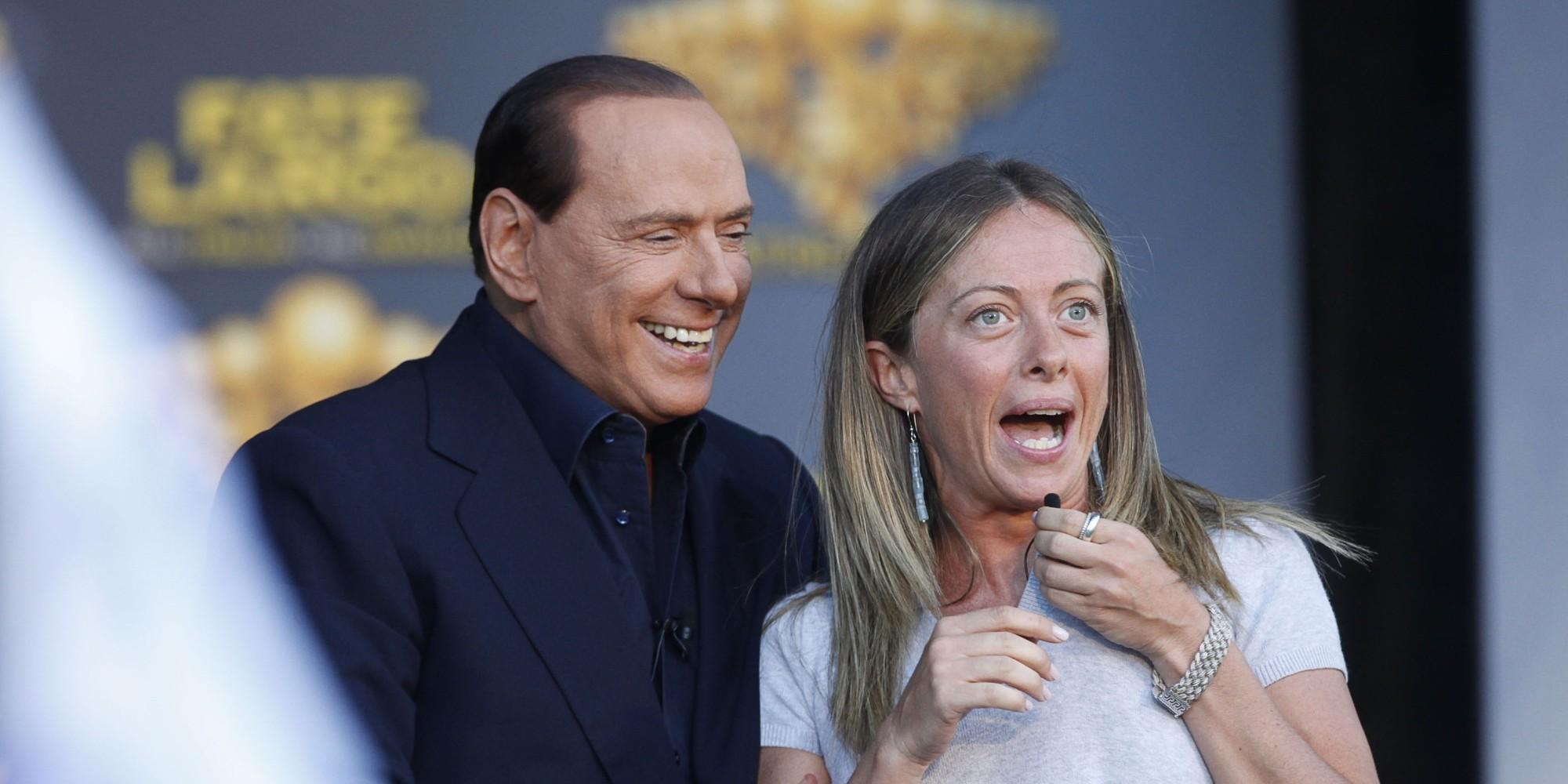 Il Presidente del Consiglio SIlvio Berlusconi ospite di Atreju, con il ministro della Gioventu', Giorgia Meloni, oggi 9 settembre 2011 a Roma. ANSA/ALESSANDRO DI MEO