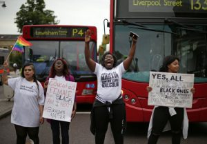 Four women hold placards and chant as protesters block the road in Brixton, south London as they protest against police brutality in the US, on July 9, 2016, after two recent incidents where black men have been shot and killed by police officers. / AFP PHOTO / Daniel Leal-OlivasDANIEL LEAL-OLIVAS/AFP/Getty Images