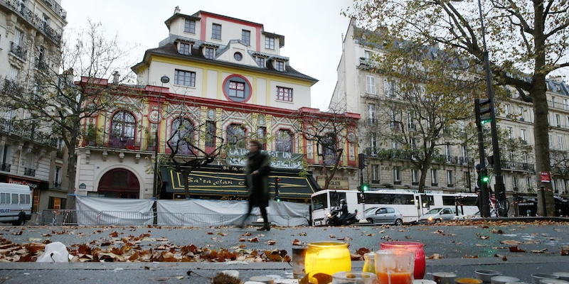 A woman walks past the Bataclan Theater in Paris on November 2015, where at least 82 people were killed during coordinated attacks in which at least 129 people lost their lives. France has listed more than 10,000 people suspected of being radicalised or potential security threats, including homegrown assailant Omar Ismail Mostefai who killed scores of people at Paris's Bataclan. AFP PHOTO/ PATRICK KOVARIK (Photo credit should read PATRICK KOVARIK/AFP/Getty Images)