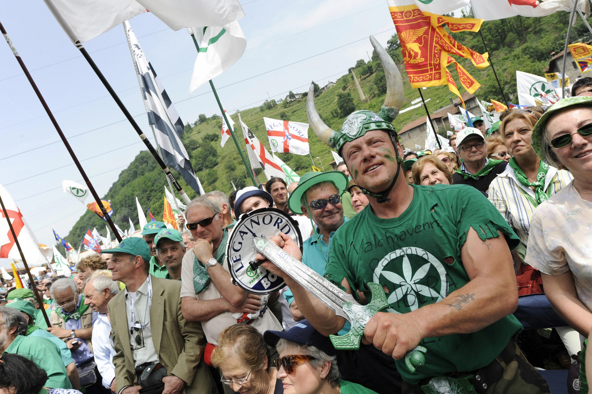 Northern League supporters attend the annual meeting of Lega Nord (North League) in Pontida, about 90 km northeast of Milan on June 1, 2008. Northern League member and Italy's Interior Minister Roberto Maroni promised a zero tolerance for illegal immigratio during his speech. AFP PHOTO / GIUSEPPE CACACE (Photo credit should read GIUSEPPE CACACE/AFP/Getty Images)
