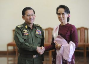 Myanmar's Commander-in-Chief Min Aung Hlaing and National League for Democracy (NLD) party leader Aung San Suu Kyi shake hands after their meeting in Naypyitaw