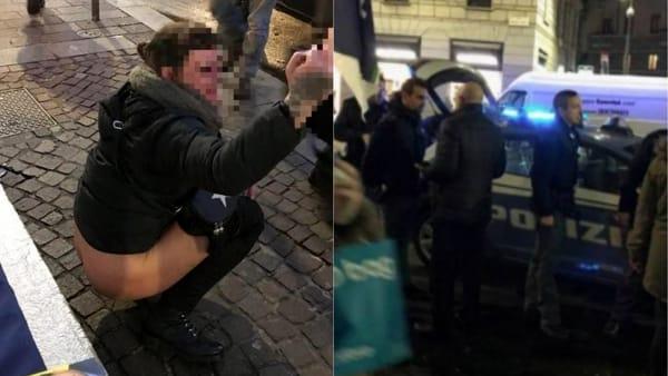 A Milano ragazza urina su bandiera di Fratelli D'Italia