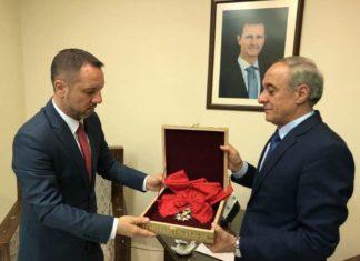 Assad Siria legion d'onore Macron