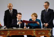 Abbraccio Merkel-Macron