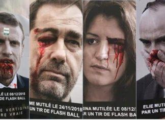 Manifesti dei gilet gialli contro la violenza Macron insaguinato
