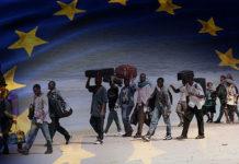 Immigrati con bandiera Ue