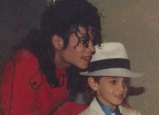foto repertorio michael jackson con bambino