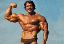 Un muscoloso Schwarznegger ai tempi del Mister Olimpia