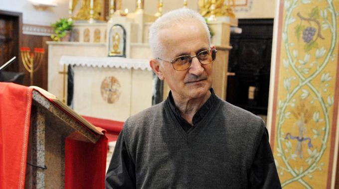 don giorgio de capitani in chiesa