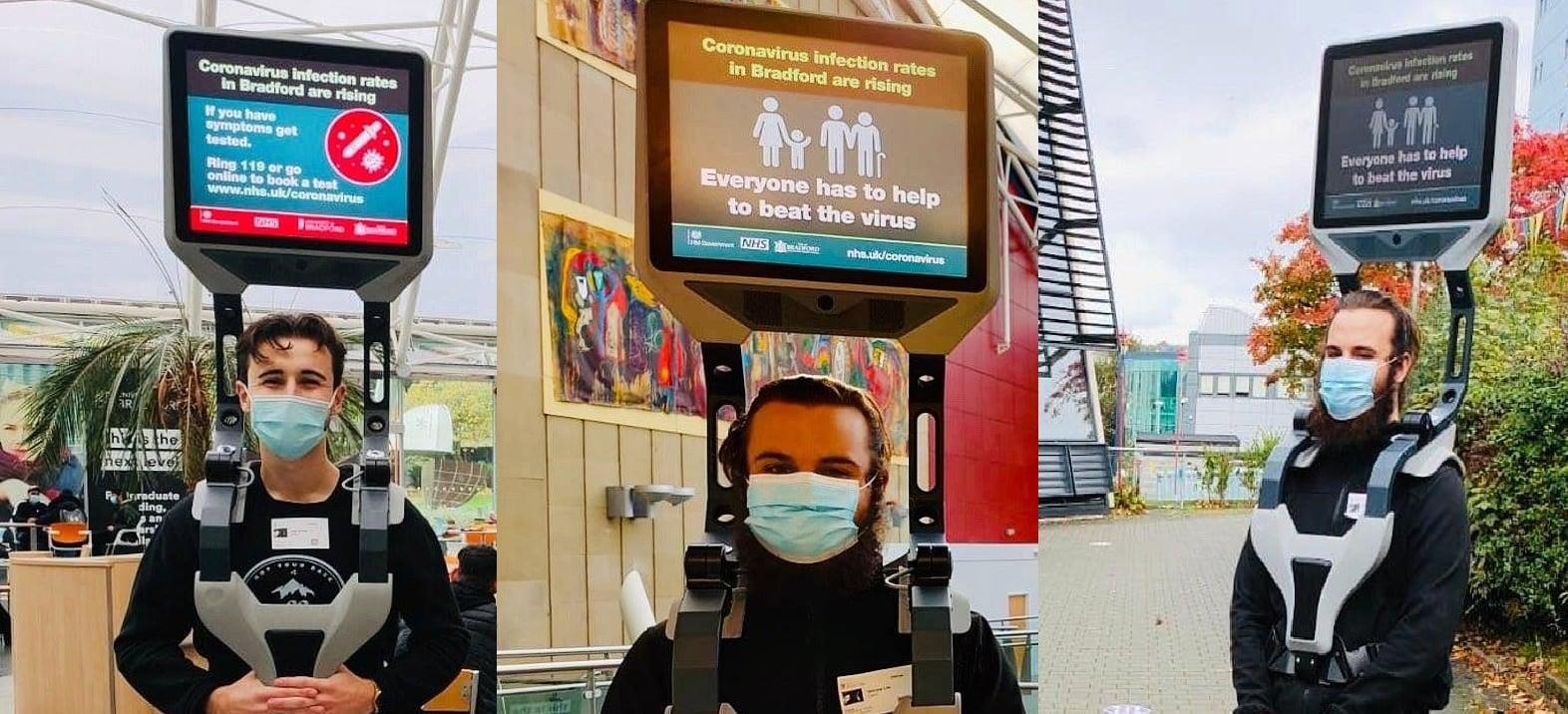 Covid, surreale iniziativa inglese: volontari con schermi sulle spalle per ricordare le norme
